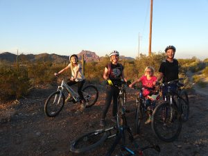 Young bikers enjoying a bike ride on Hawes Trail with views of Red Mountain. Photo courtesy of Emily Boyle