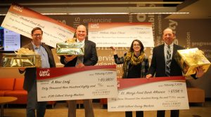 Leaders of the four local nonprofits received very large checks from The Church of Jesus Christ of Latter-day Saints thanks to patrons of the Gilbert Giving Machines. Left to right: Dave Richins, Michael Hughes, Katy Pompay and Tom Kertis. Photo by Robin Finlinson.