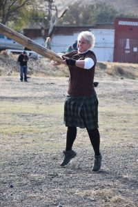 "Competing in Scottish Highland Games gives Michelle Galloway Lowe a chance to combine her interest in her Scottish ancestry with her love for ""throwing heavy things,"" as she does in the caber toss, shown above. Photo courtesy of Michelle Galloway Lowe"