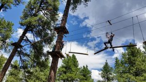 Olivia Knippers maneuvers log obstacle at Flagstaff Extreme. Photo by Emily Boyle