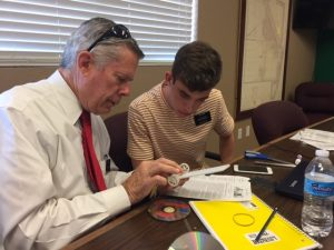 Elder Steadman working with Elder Kerr on a solar powered dragster project for children visiting Dysart Community Center. Photo by Sister Therese Steadman