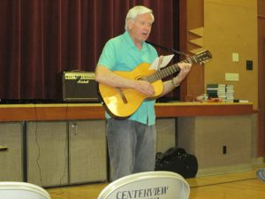 John Keller plays the guitar in a recent monthly gathering. Photo courtesy of Harvey Zilm