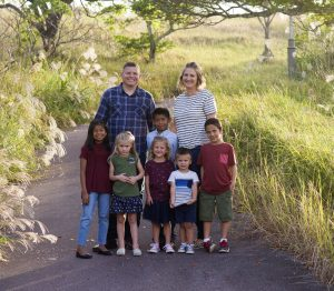 The Peterson family, of the Gushikawa Branch in the Okinawa Military District, with their children, both biological and adopted. Two of their children were in the foster care system for years and have since found a forever family in the Petersons. Photo by Lori Shirley